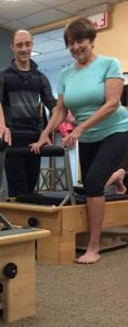 EMPS Pilates Teacher Kevin Earll with client on Reformer