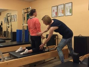 EMPS Pilates Teacher Sabine Gisiger with client on Reformer