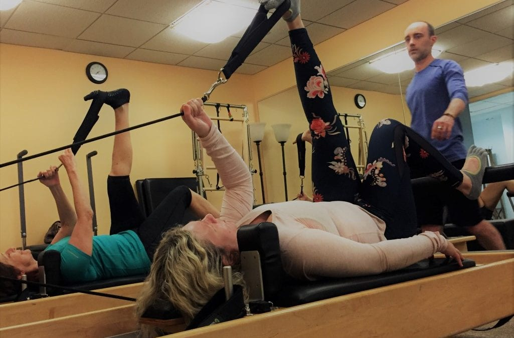 Embody Movement Pilates Teacher Kevin Early with Group Reformer Class